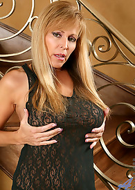 Glamorous Anilos cougar Nicole Moore looks seductive in her sheer lace dress