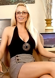 Long blonde haired Anilos beauty masturbates in her office