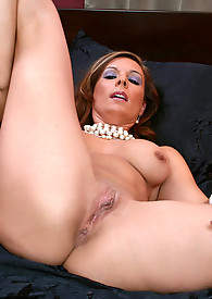 Tan brunette milf finds a thick dildo to play with