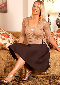 Classy blonde cougar pulls up her long skirt