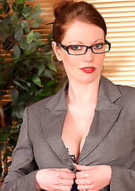 Underneath her business suit Holly Kiss hides her naughty side